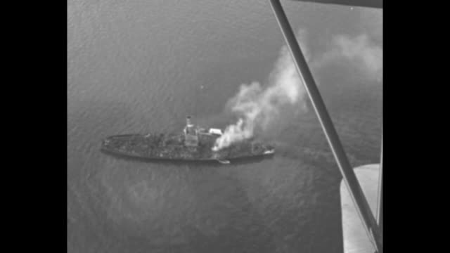 "vídeos y material grabado en eventos de stock de aerial view of the ""augusta c. quinn"" on fire in chesapeake bay / wreckage of the ship and twisted debris / vs cameraman seated on pole above the... - dañado"