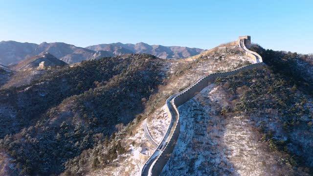 aerial view of the badaling great wall after snow on december 13 in beijing, china. - badaling stock videos & royalty-free footage