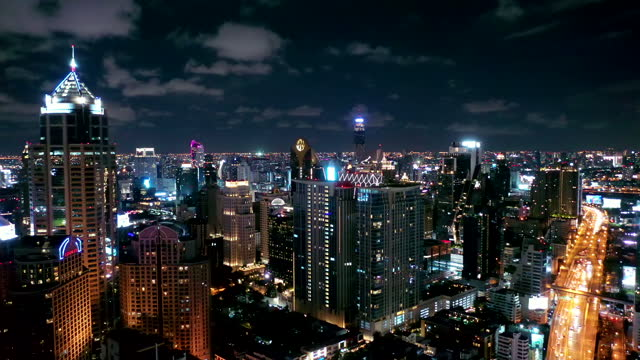 aerial view of the bangkok landmark financial business district with skyscraper on sukhumvit district in bangkok during night time - elevated train stock videos & royalty-free footage