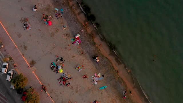 vídeos de stock e filmes b-roll de aerial view of the beach town of saint-cyr sur mer in the south of france - water's edge