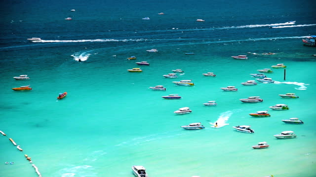 aerial view of the beach with boats and jet skis - chonburi province stock videos & royalty-free footage