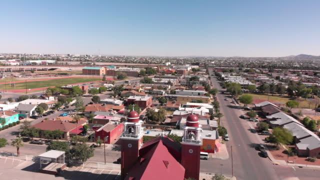 stockvideo's en b-roll-footage met luchtfoto van de prachtige oude missie stijl saint ignatius kerk in el paso, dicht bij de grensovergang - spanish culture