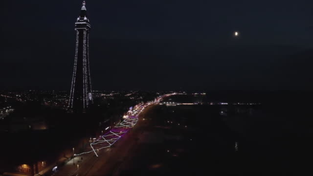 aerial view of the blackpool tower illuminations during the coronavirus crisis - luminosity stock videos & royalty-free footage