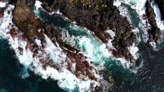 aerial view of the blue ocean in the volcanic coastline at the azores islands. - atlantikinseln stock-videos und b-roll-filmmaterial