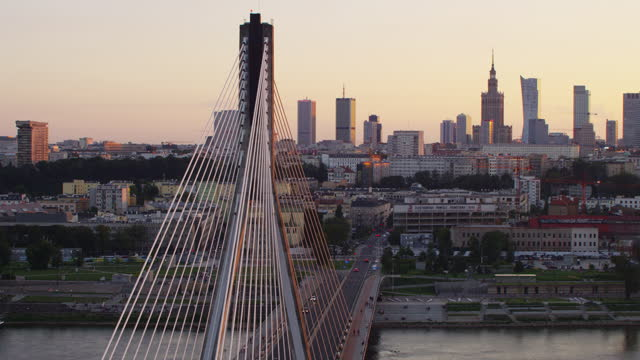 aerial view of the bridge. vistula river and distant warsaw skyline at sunset - warsaw stock videos & royalty-free footage