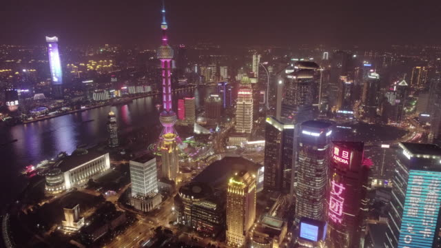 aerial view of the bund of shanghai in night - flowing stock videos & royalty-free footage