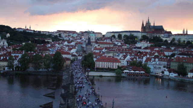 aerial view of the charles bridge on the vltava river during sunset.. - river vltava stock videos & royalty-free footage