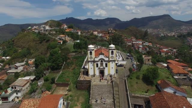 aerial view of the church of nossa senhora da conceicao in ouro preto - preto stock videos & royalty-free footage