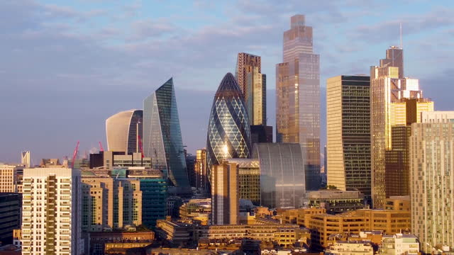 aerial view of the city of london with the sun glinting off 30 st mary axe (the gerkin.) - aerial stock videos & royalty-free footage