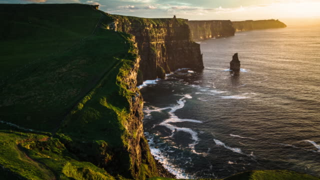 aerial view of the cliffs of moher at sunset. ireland. - cliff stock videos & royalty-free footage