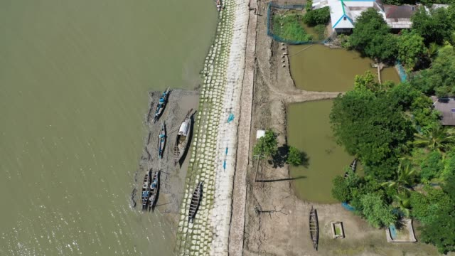 vidéos et rushes de aerial view of the coastal area's embankments in bangladesh on august 21, 2020. - exclusivité