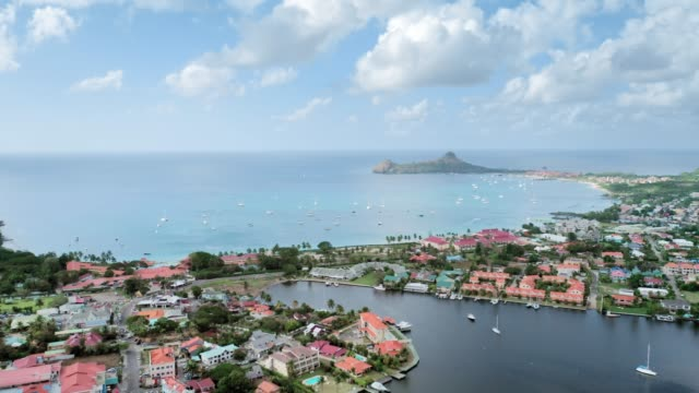 aerial view of the coastal city, yachts in the sea and protruding rock.(rodney bay, saint lucia) - 船の一部点の映像素材/bロール