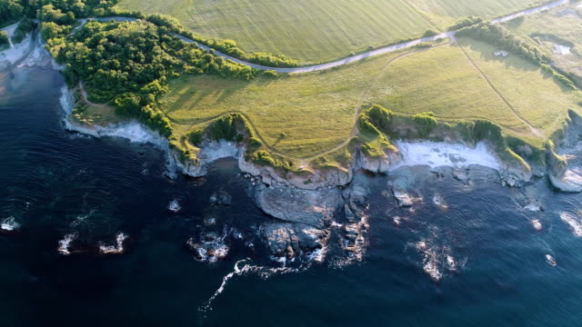 Aerial view of the coastline at sunset.
