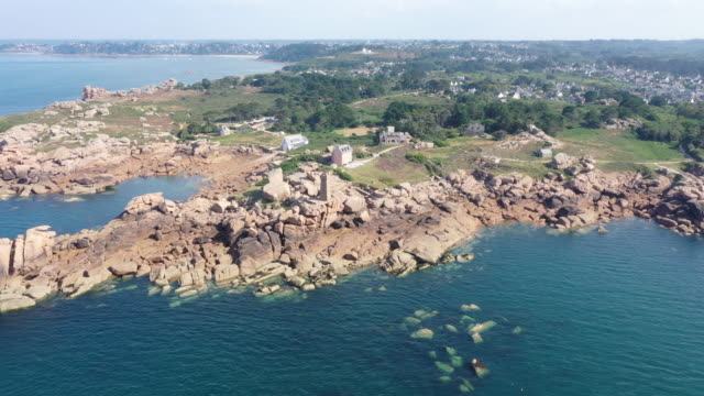 aerial view of the coastline in cote de granit rose around lannion, red cliff rocks at sunset, brittany, france - granite rock stock videos & royalty-free footage
