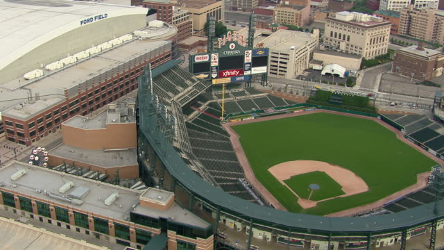 aerial view of the comerica park baseball stadium in downtown detroit, michigan. - detroit michigan stock videos and b-roll footage