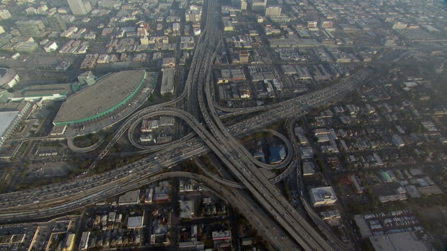 stockvideo's en b-roll-footage met aerial view of the la convention center and an interchange of interstates 10 and 110 in central los angeles. - los angeles convention center