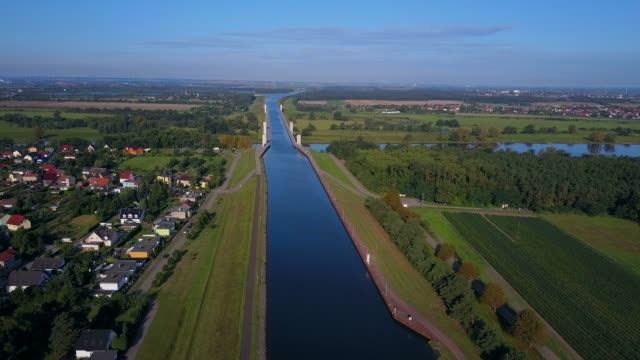 aerial view of the crossing of mittelland channel and elbe river near magdeburg, saxony-anhalt, germany - sea channel stock videos and b-roll footage