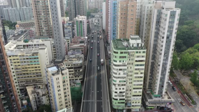 aerial view of the crowded kowloon city in hong kong - housing development stock videos & royalty-free footage