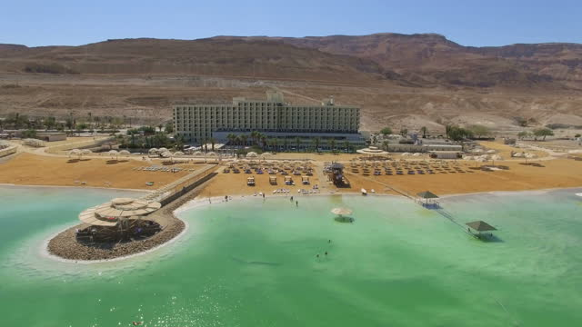 aerial view of the dead sea hotels on a sunny day - dead sea stock videos and b-roll footage