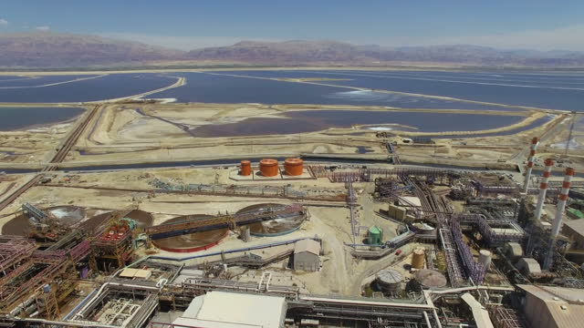 aerial view of the dead sea works with the dead sea in background - salt mineral stock videos & royalty-free footage