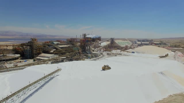 aerial view of the dead sea works with the dead sea in background - ダンプカー点の映像素材/bロール