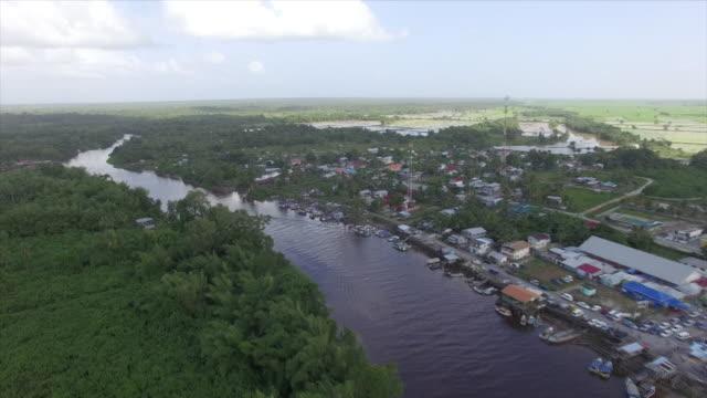 aerial view of the demerara river near georgetown, guyana - guyana stock videos & royalty-free footage