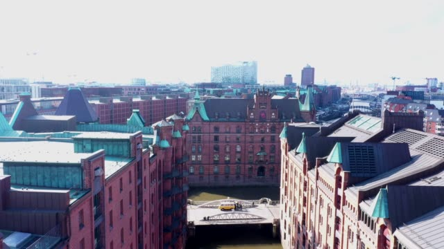 aerial view of the elbe philharmonic hall in hamburg in germany. in the foreground the largest warehouse district in the world, the warehouse... - design element stock videos & royalty-free footage