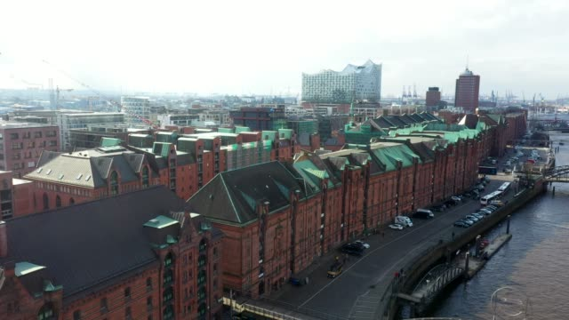 aerial view of the elbe philharmonic hall in hamburg in germany. in the foreground the largest warehouse district in the world, the warehouse... - brick stock videos & royalty-free footage