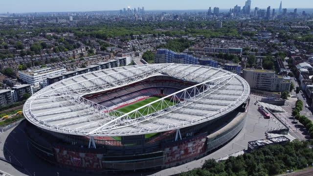 aerial view of the emirates stadium. london skyline behind. tracking shot. - video stock videos & royalty-free footage