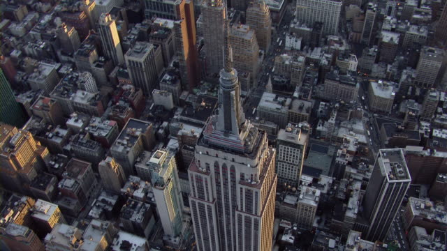 Aerial view of the Empire State Building and neighboring rooftops in Midtown Manhattan, New York City.
