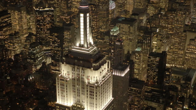 aerial view of the empire state building at night light. urban business district