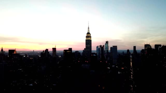 aerial view of the empire state building during sunset in new york city new york - エンパイアステートビル点の映像素材/bロール