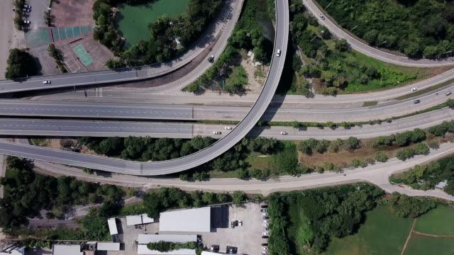 vídeos de stock e filmes b-roll de aerial view of the expressway junction and traffic transportation - road junction