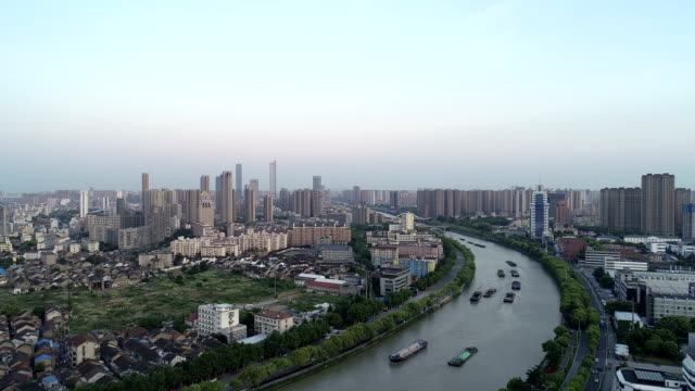 aerial view of the famous canal city of wuxi - majestic stock videos & royalty-free footage