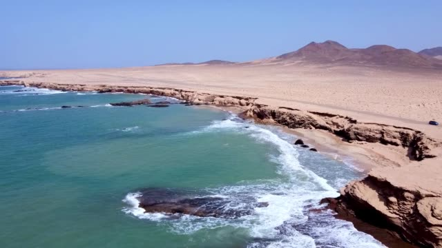 aerial view of the famous los ojos beach, fuerteventura, spain - volcanic terrain stock videos & royalty-free footage
