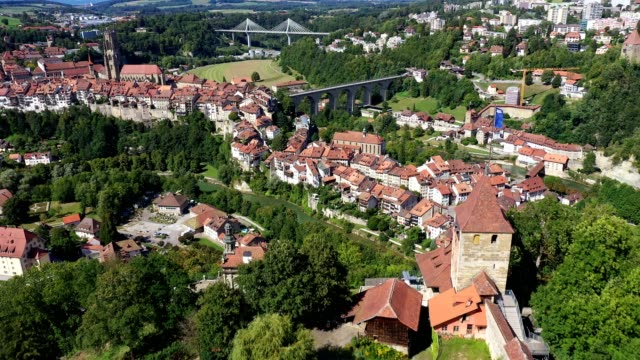 aerial view of the fribourg old town in switzerland - andersherum stock-videos und b-roll-filmmaterial