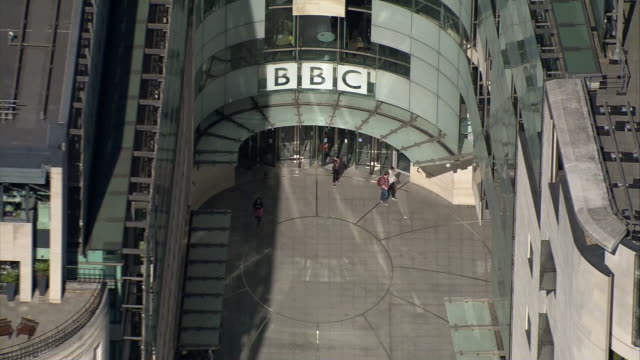 vidéos et rushes de aerial view of the front entrance to bbc broadcasting house - bbc