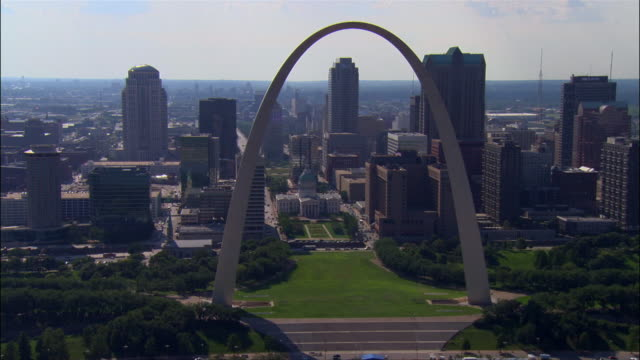 Aerial view of the Gateway Arch / zoom out to wider view of downtown area and the Mississippi River / St. Louis, Missouri