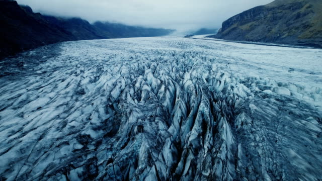 aerial view of the glacier in iceland - horizontal stock videos & royalty-free footage