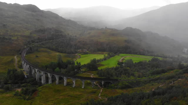 aerial view of the glenfinnan train viaduct with autumn colors in scotland. - viaduct stock videos & royalty-free footage
