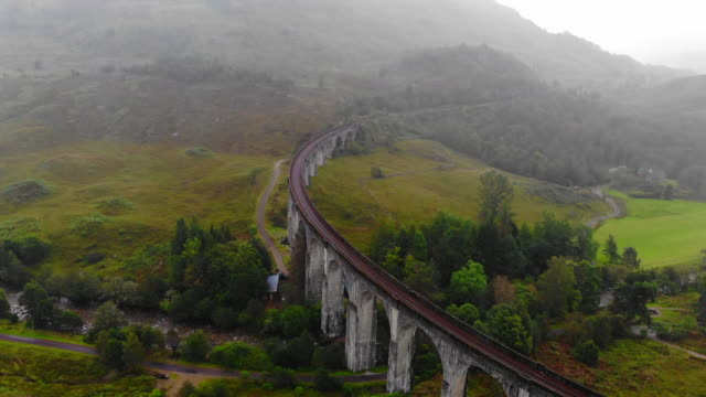 aerial view of the glenfinnan train viaduct with autumn colors in scotland. - curve stock videos & royalty-free footage