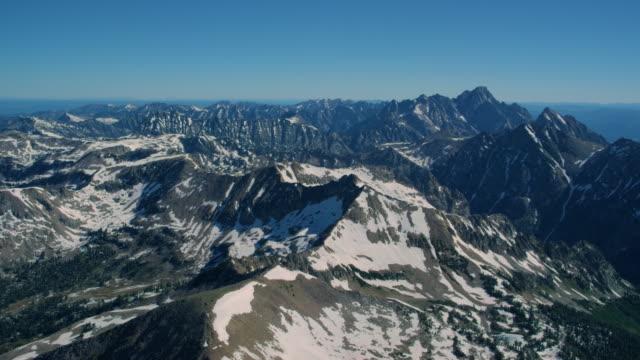 aerial view of the grand teton mountains - teton range stock videos & royalty-free footage