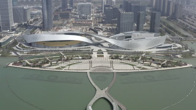 stockvideo's en b-roll-footage met aerial view of the grand theater in suzhou bay cultural center in suzhou taihu new city district, suzhou, china - mar