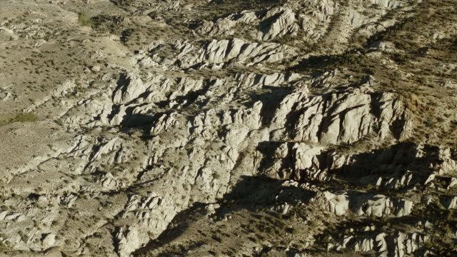 aerial view of the granite rock formations known as the buttermilks, sierra nevada, california. - naturwunder stock-videos und b-roll-filmmaterial