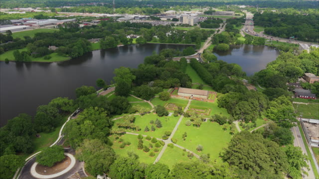 aerial view of the grounds and old arsenal powder magazine at the louisiana state capitol in baton rouge - baton rouge stock-videos und b-roll-filmmaterial