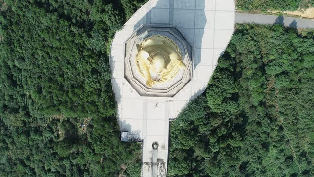 aerial view of the guanyin bodhisattva - male likeness stock videos & royalty-free footage