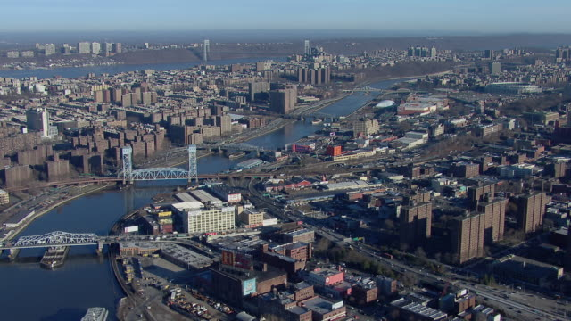 Aerial view of the Harlem River between East Harlem and the Bronx in New York City. The river is traversed by multiple swing bridges as well as the Park Avenue vertical lift railroad bridge.