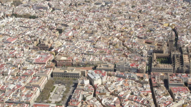 aerial view of the historic center of Seville with - in order of appearance - Plaza Nueva, Cathedral and Giralda belfry, Archivos de las Indias, Maestranza bullring, Meastranza theater and Torre de Oro