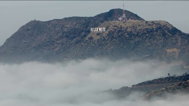 aerial view of the hollywood sign and fog on march 31, 2015. - hollywood california stock videos & royalty-free footage