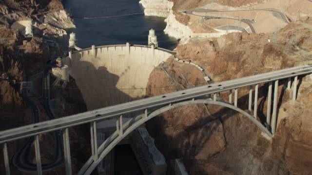 aerial view of the hoover dam and mike o'callaghan–pat tillman memorial bridge - hydroelectric power stock videos and b-roll footage